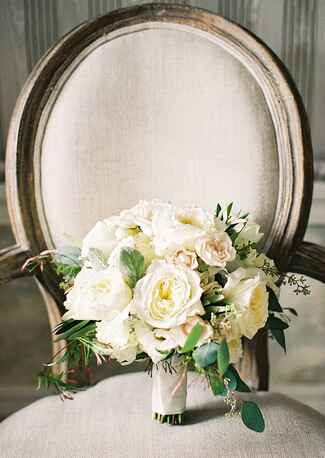 White bridal bouquet on armchair