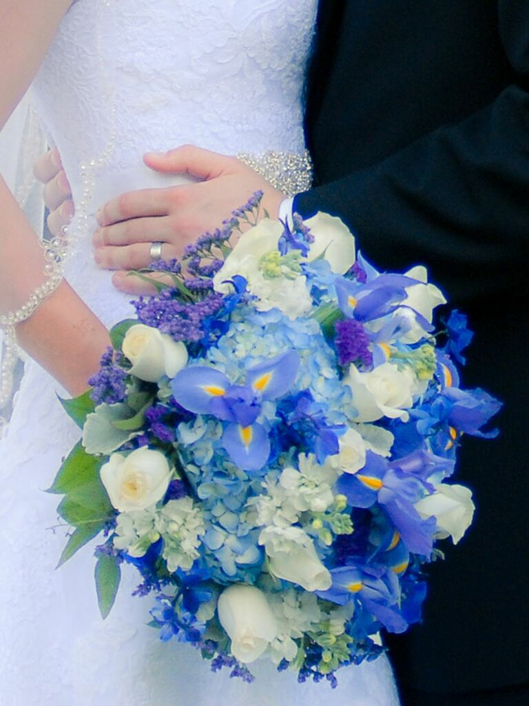 The best blue wedding flowers and 16 gorgeous blue bouquets blue wedding bouquet with irises hydrangea roses stock flower junglespirit Images
