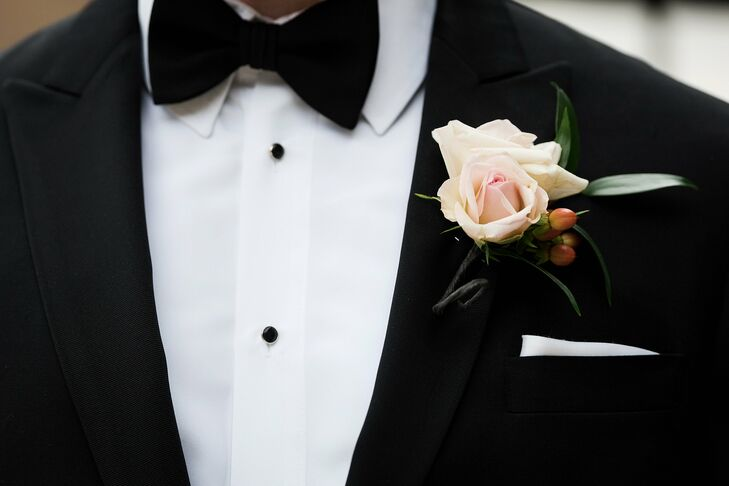Alan and his groomsmen wore blush rose blooms accented with red hypericum berries for their boutonnieres. They loved the classic look and how they matched the other classic floral arrangements.