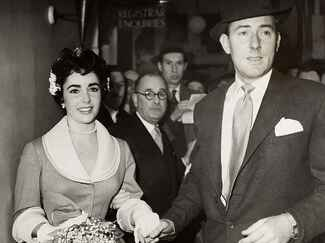Elizabeth Taylor and Michael Wilding on their wedding day in 1952.