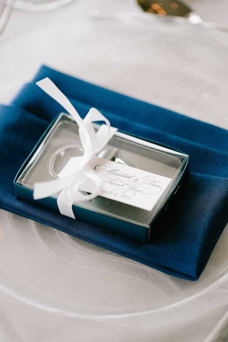 Elegant hand-calligraphed place cards were attached to customized bottle-opener favors at each setting.