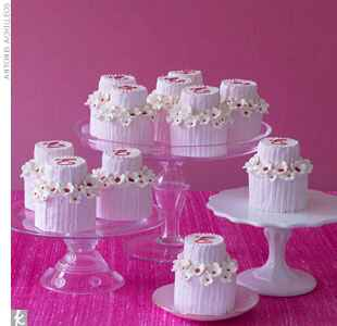 mini wedding cakes on a pink backdrop