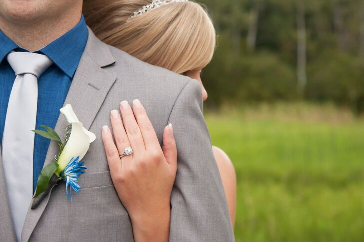 James wore a white calla lily boutonniere offset by a bright blue spider mum.