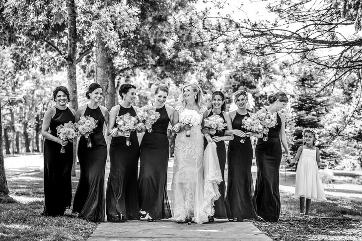 The bridesmaids wore classic floor-length black dresses from Wtoo by Watters. Stephanie loved how timeless they all looked, especially with the traditional groomsmen tuxedos, for the traditional Catholic ceremony.
