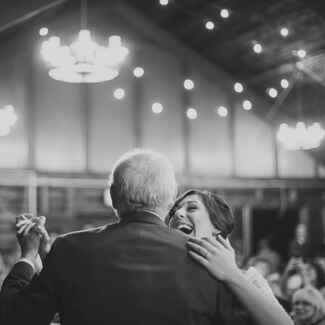 Father-daughter dance at rustic barn wedding reception