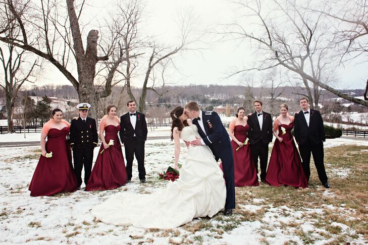 The bridesmaids wore strapless, floor length red dresses from Bill Levkoff, which they wore with stoles for the winter weather.