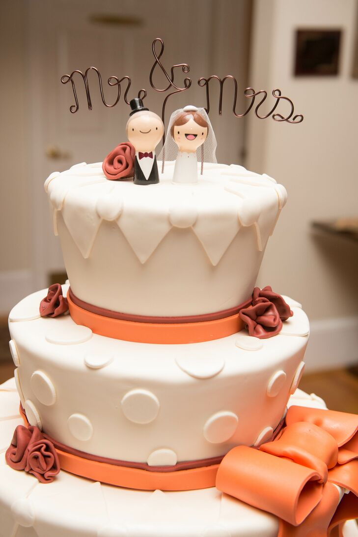 The ivory, orange and maroon cake was decorated with fondant and featured a cute cake topper from Etsy.