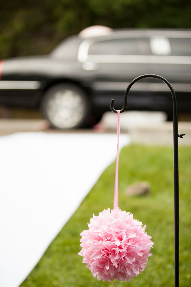 Pink flower kissing balls added a touch of romance to the outdoor wedding flowers.