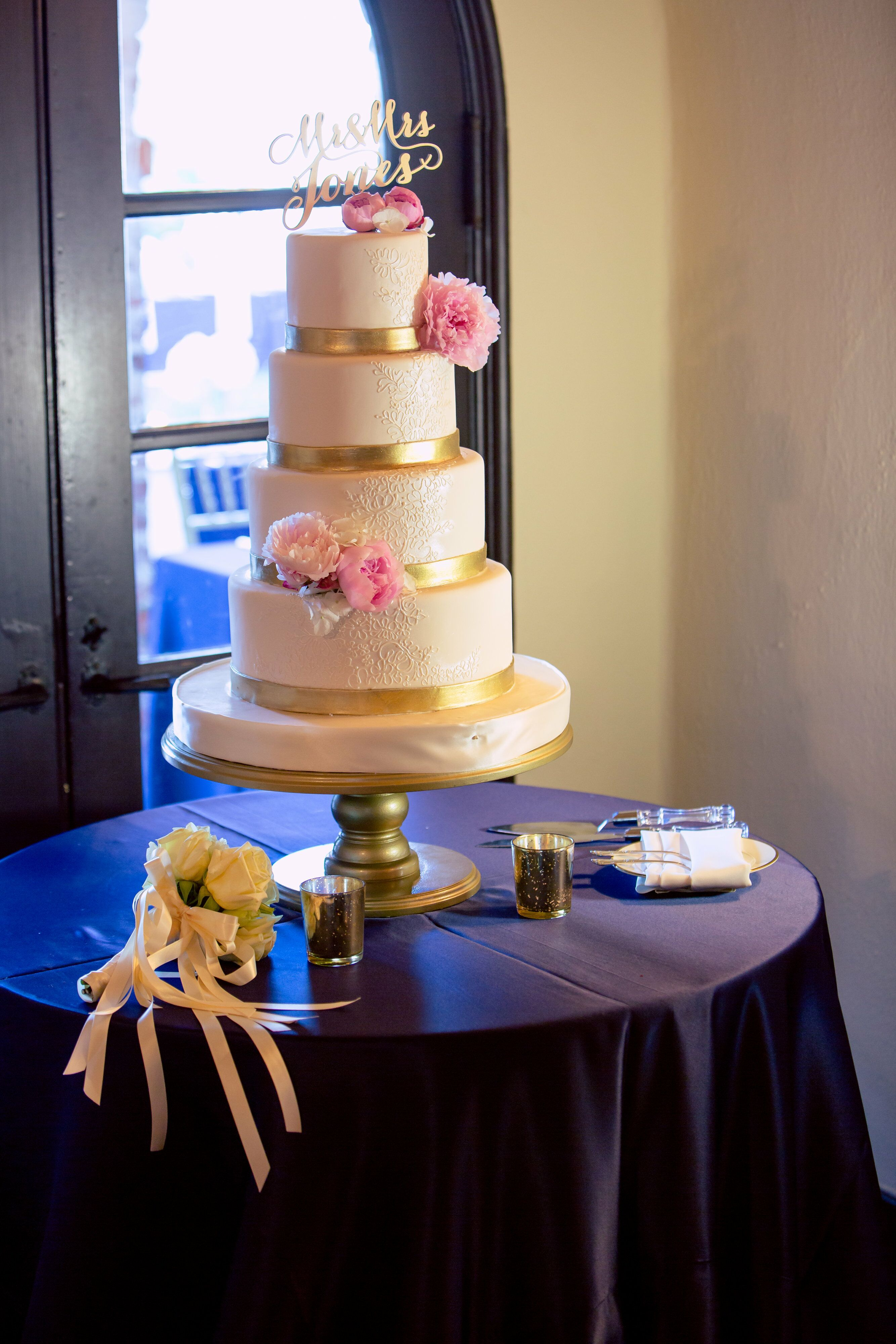 Four Tier Ivory And Gold Wedding Cake