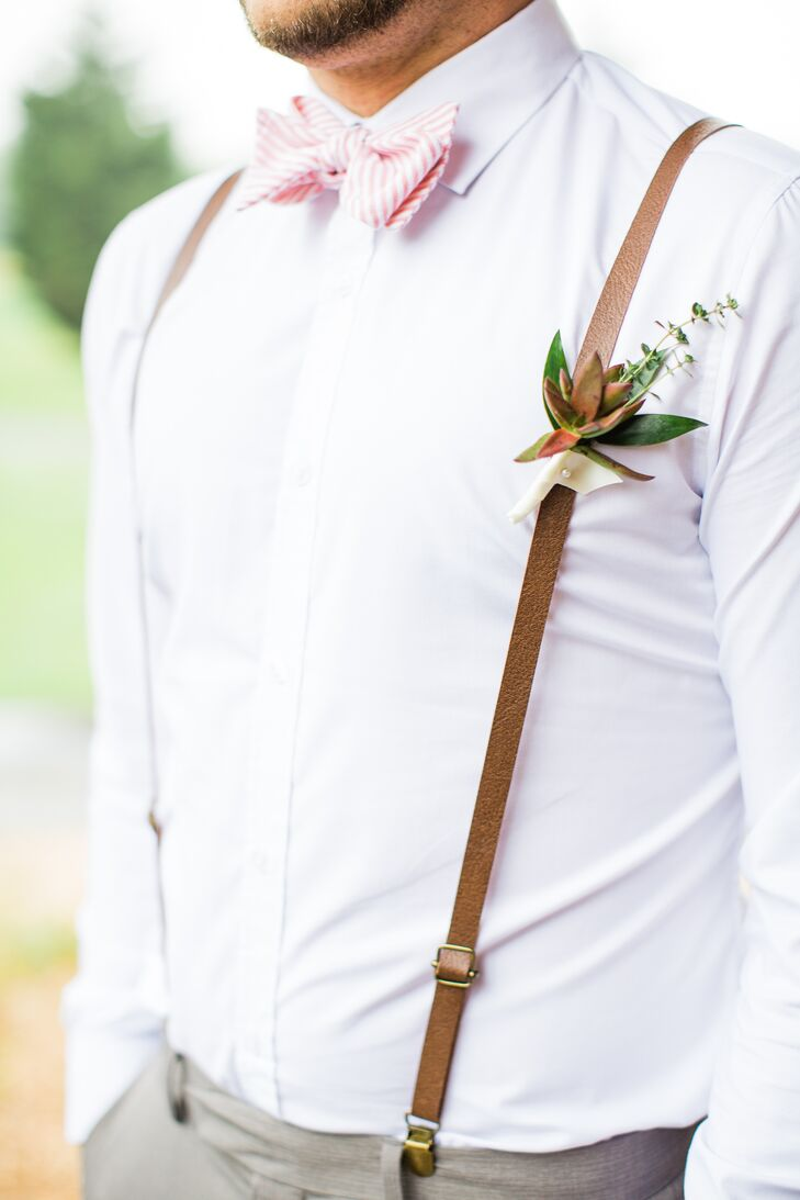 Sophia and Jake really wanted their wedding party to be comfortable for the garden party wedding. The groomsmen wore gray slacks with white shirts, and Jake gave each of them leather suspenders and red and green succulent boutonnieres to complete their look.