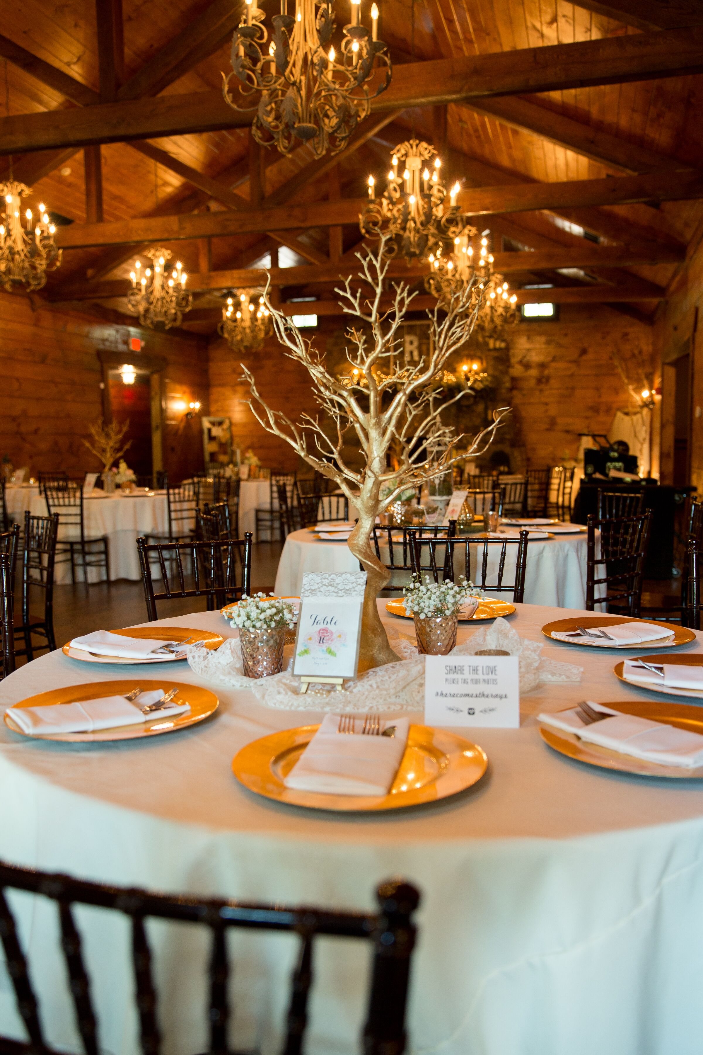 Gold branch centerpieces with chargers
