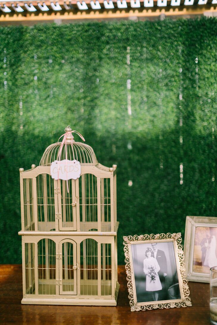 A birdcage card holder added an elegant vintage look to the gift table.