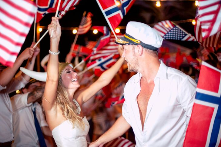 Sarah and Morten danced their way out of the reception wearing their themed prop hats while guests waved both American and Norwegian flags.
