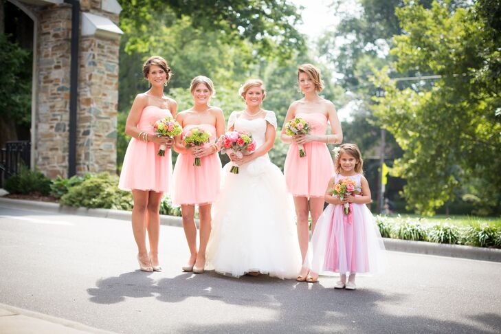 Mallory opted for a fun, laid-back look for her bridesmaids. The girls wore short pale pink dresses with a strapless neckline and light chiffon material.