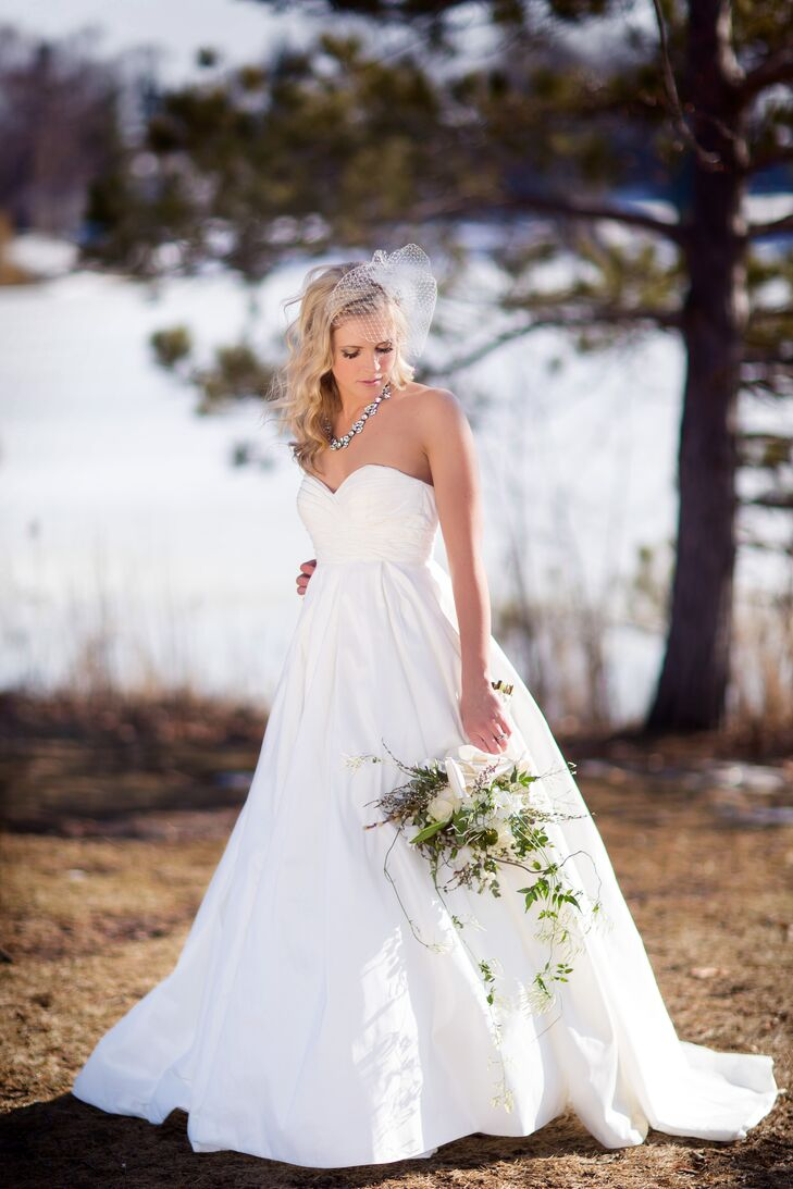 Bride in Strapless, A-Line Wedding Dress with Down Hairstyle and ...