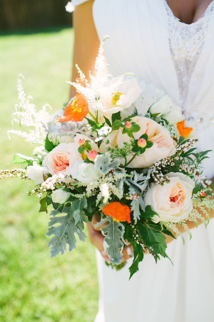 Lauren's bouquet was filled with blooms straight from her mother's garden. A fresh mix of blush garden roses, bright orange poppies, white anemones and an assortment of wispy greenery came together to create a whimsical look with a note of playfulness.