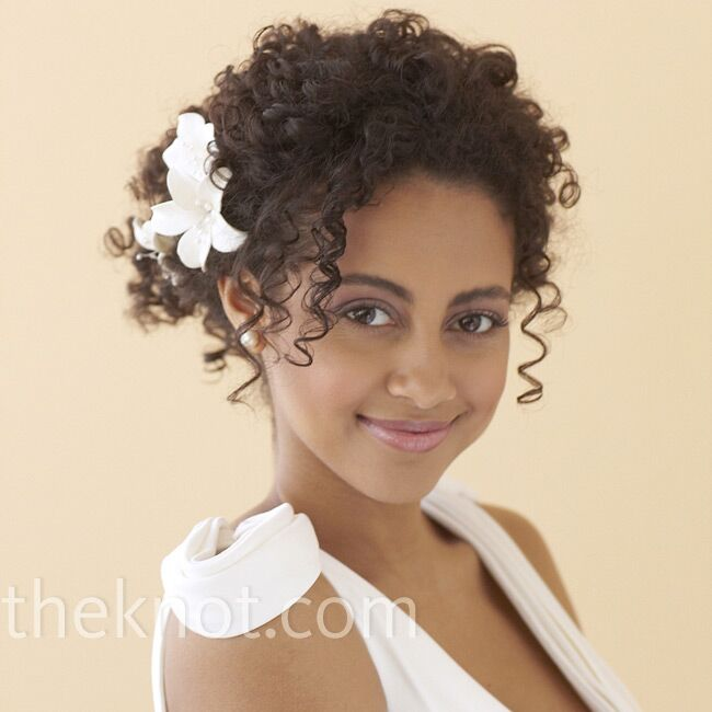 tendril curl wedding hairstyle with a flower headpiece