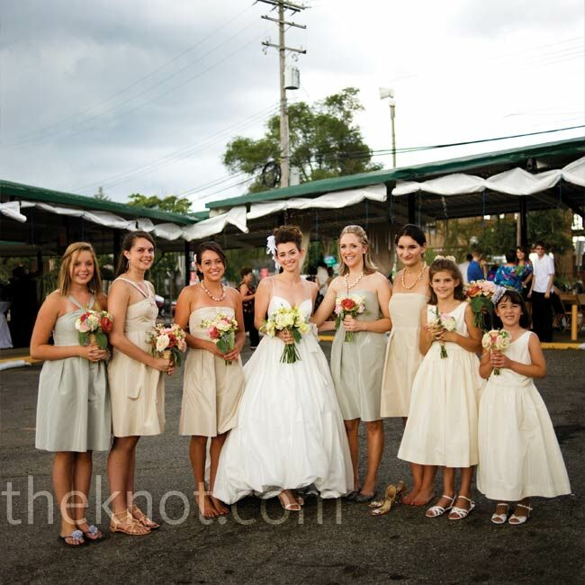 5ba9743d2e6 All the bridesmaids wore pewter and champagne dresses in various styles to  serve as a base