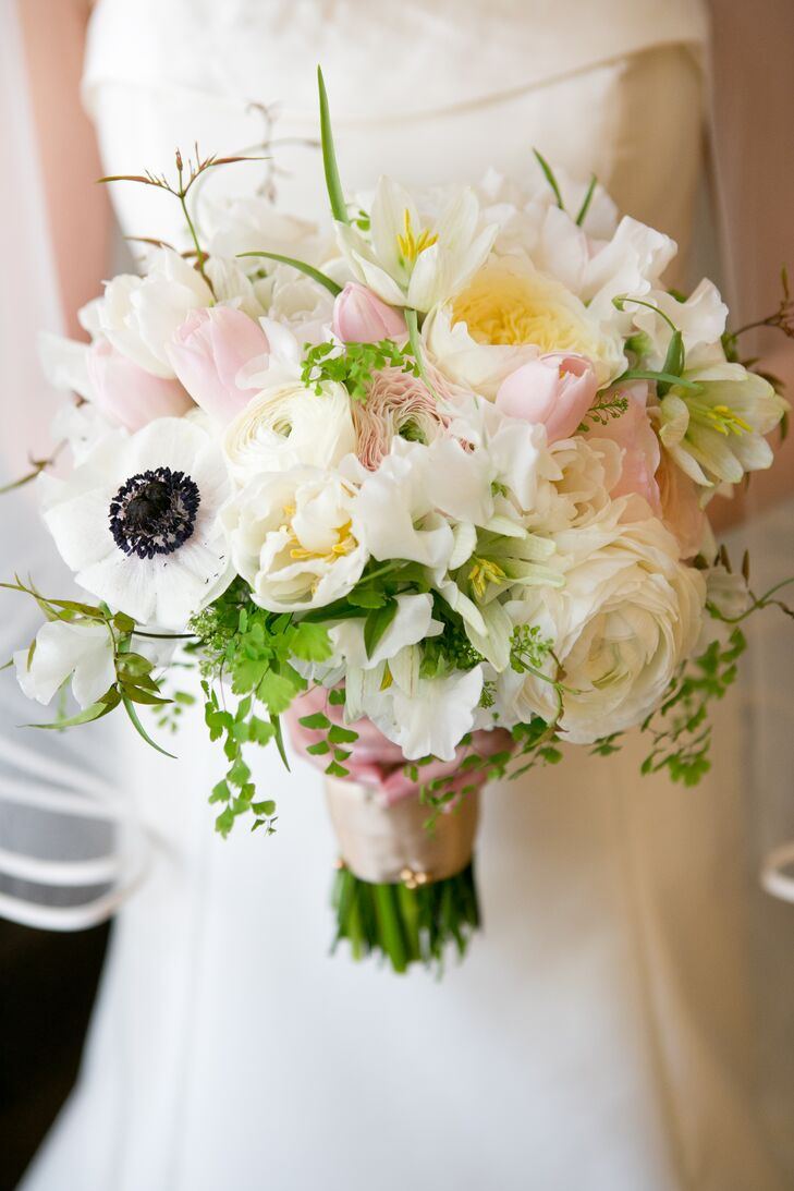 With tulips being one of her favorite flowers, a spring wedding was a must for Alexandra. Petalena Flowers created a romantic, spring-inspired bouquet for her walk down the aisle, filling the arrangement with garden roses, tulips, anemones, peonies ranunculuses lisanthuses and ferns in soft shades of white, ivory and blush pink.