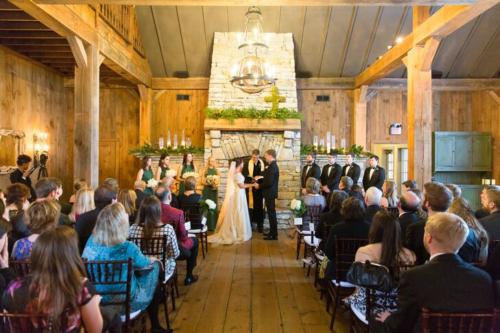 "Emily and Edward kept their ceremony decorations to a minimum since Old Edwards Inn and Spa in Highlands, North Carolina, was beautiful on its own. ""The Barn pavilion itself does not need much decor,"" Emily says. ""It already is so lovely with the stone floors, huge fireplaces, wood beams and glass windows."""