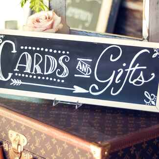 Chalkboard cards and gifts sign at wedding reception