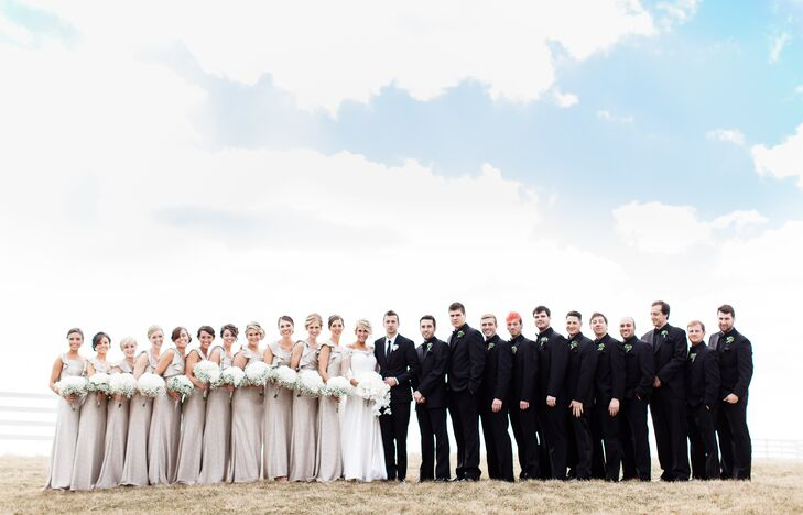 Jenna, Tyler and their wedding party stood outside at the IronGate Equestrian Center in Hartford, Ohio. The bridesmaids embodied elegance and class through one-shoulder champagne-colored dresses, while the groomsmen wore black tuxedos to match Tyler's black suit.