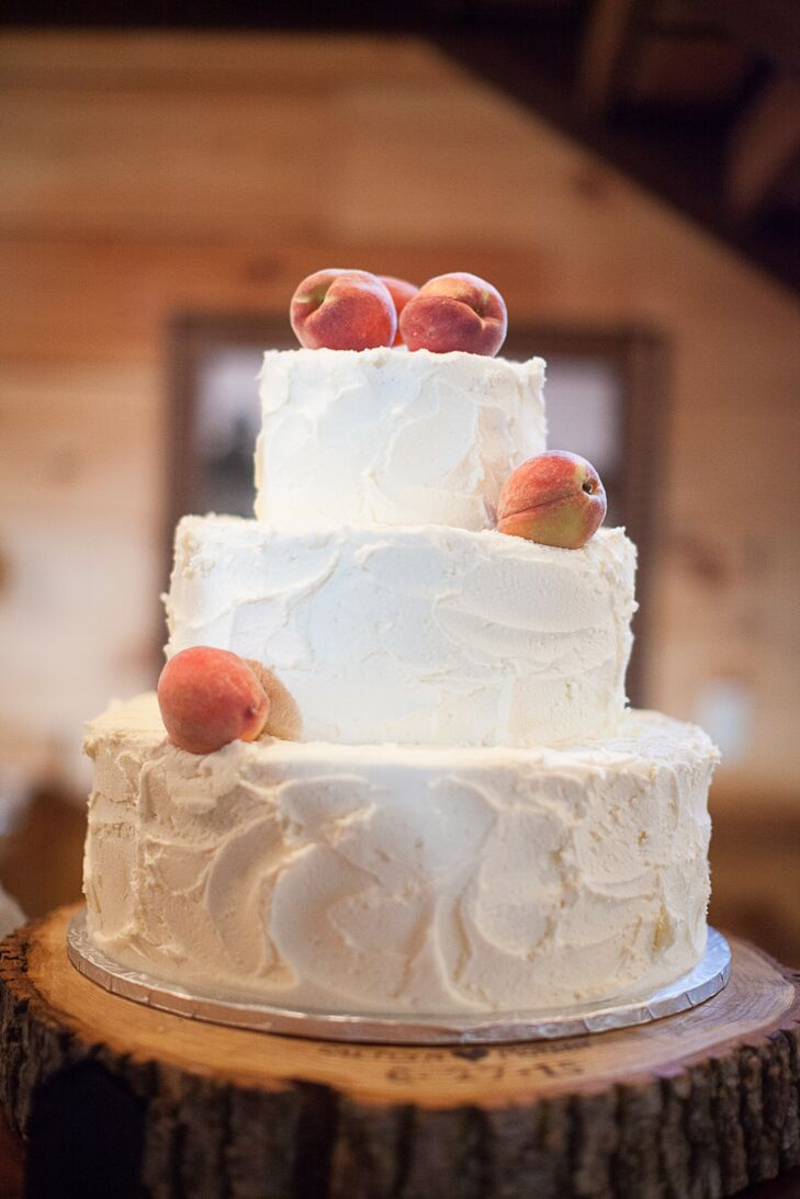 An image of a white buttercream wedding cake with sugar-coated peaches inspired the entire Georgia wedding theme, so that's what Caitlyn and Morgan had as their own cake. The textured, natural style was perfect for the rustic farm wedding.