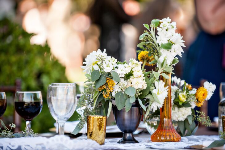 The bride and groom went for a rustic-meets-modern vibe, with raw wooden tables and platters, old lace runners, bronze candlesticks and mercury glass lanterns.
