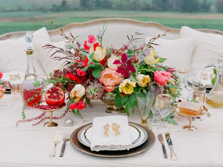 Pomegranate, tulip and peony centerpiece