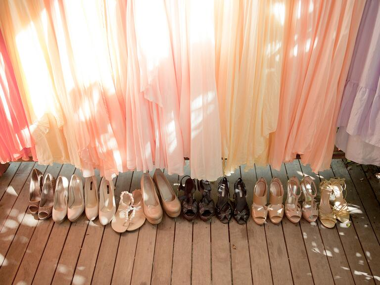 Bride and bridesmaids shoes lined up at a wedding reception with one set of shoes clashing