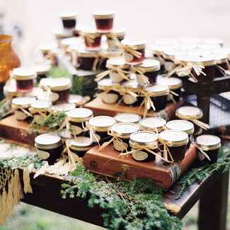 Jars of homemade jam on a wooden tray