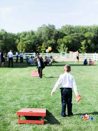 Lawn games cornhole for an outdoor wedding reception