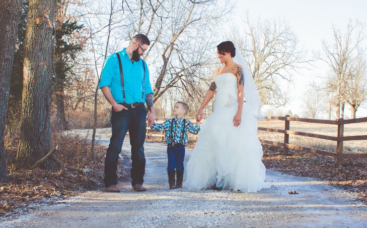 """My wedding dress was a no-brainer for me,"" Amanda says. ""It had every aspect I wanted. I'm tall, so the high-low style was perfect. The cut beautifully showcased my cowboy boots, which were teal and brown to match the wedding colors. The dress was just poufy enough to make me feel like a princess, but simple and lightweight enough to be comfortable and not feel gaudy."""