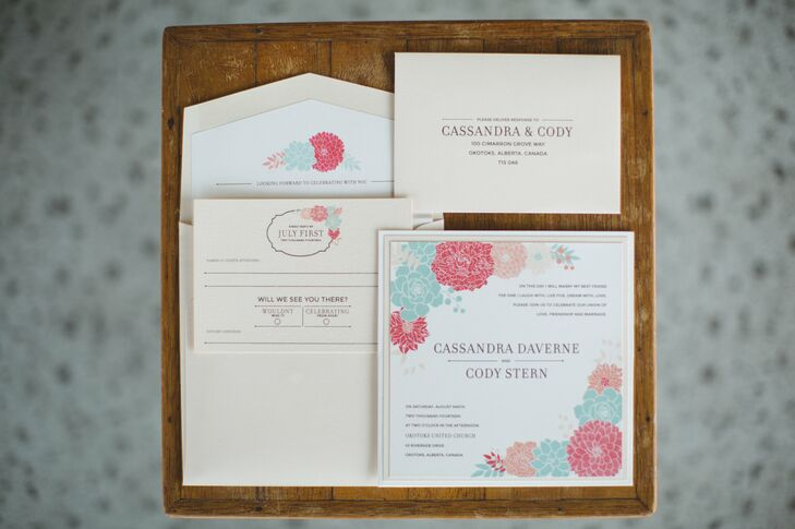 Aqua blue and coral illustrated flowers decorated the cream colored invitation suite.