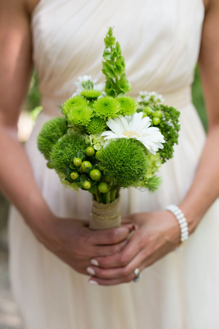 The bridesmaids carried bouquets of green trick dianthus, bells of Ireland, kermit mums, green hypericum berries complemented by a white gerbera daisy.