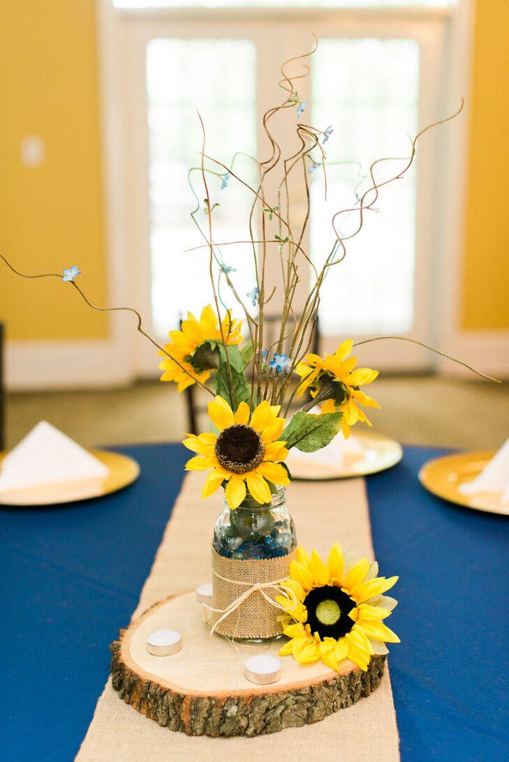 Low sunflower centerpiece in glass jar