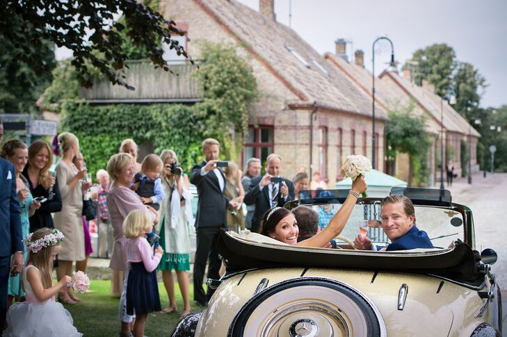 Bride and Groom Exit in Classic Vintage Cream Car