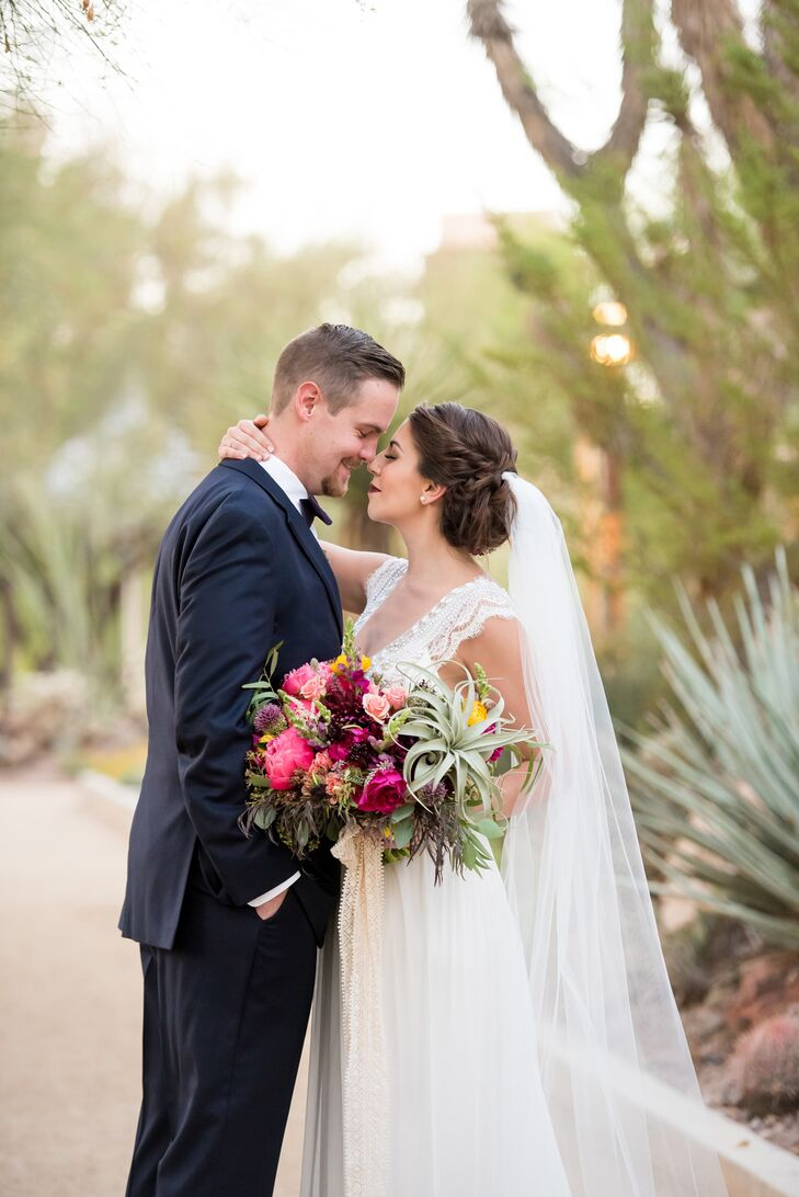 "Jenna's hair and gown fit the naturally beautiful, flower-rich setting. ""My dress had beautiful beaded detailing at the top, with delicate lace sleeves, a low back and a cathedral-length veil,"" Jenna says."