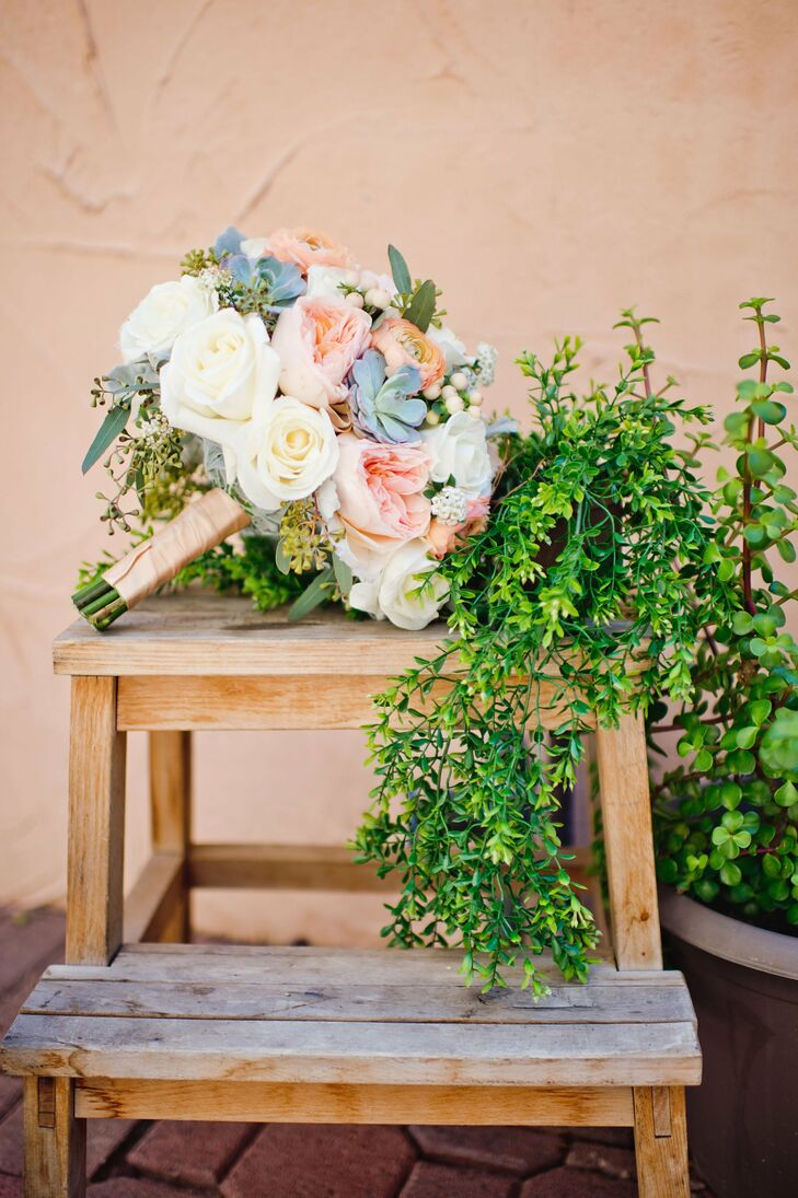 Succulents, bright white roses and blush pink and peach blossoms complemented the desert setting.