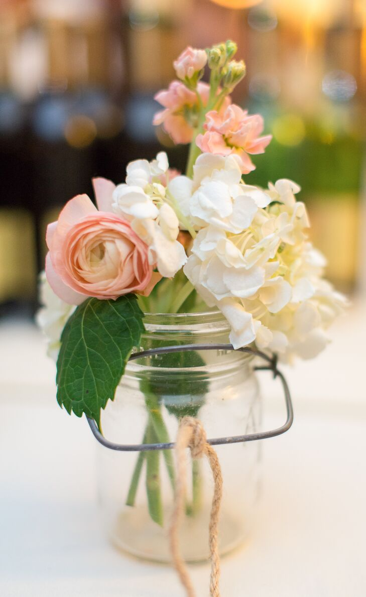 Pink ranunculus and ivory hydrangea centerpieces