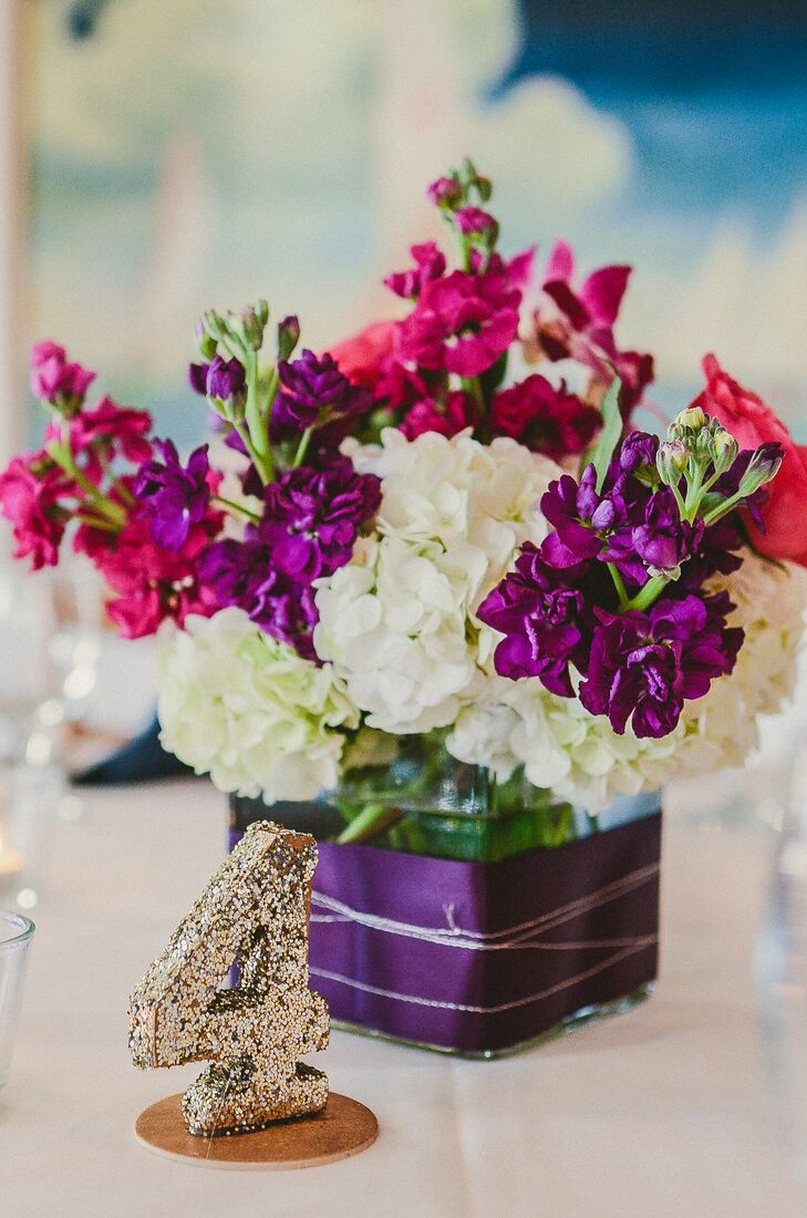 Low white hydrangea and purple stock centerpiece