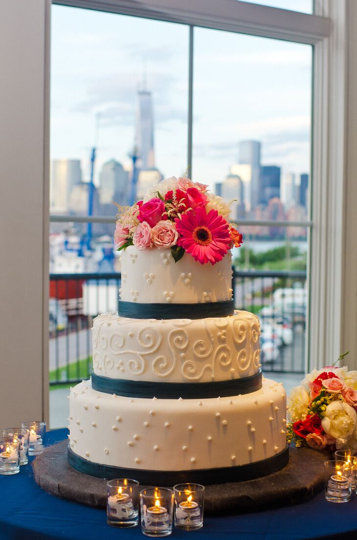 Three Tier Patterned Wedding Cake with Navy Stripes and Coral Flowers