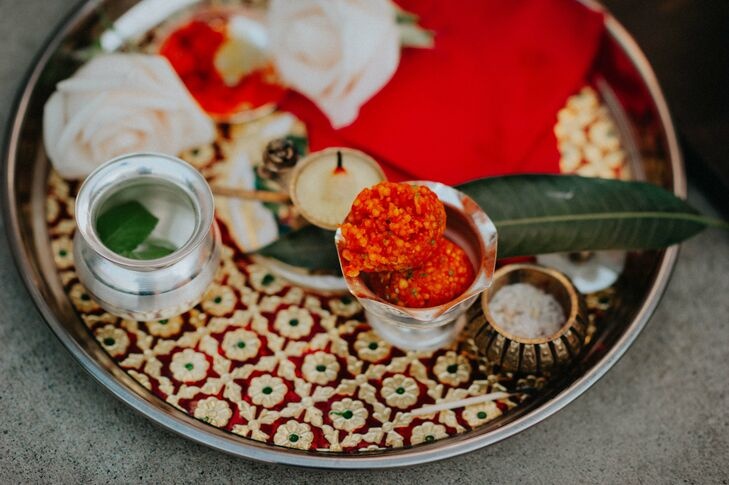 Anjali and Christophe included a traditional puja thali into their ceremony, a lavish gold, red and green platter equipped with all the necessary elements used to pray for the bride and groom to welcome each other into their new life together.