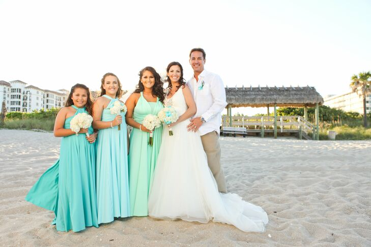 "Curt's three daughters were chosen as Rachel's bridal party. Each girl wore a seafoam green, light blue or turquoise convertible dress in her chosen style. ""I instantly fell in love with a watercolor dress that had colors of the ocean, like a mermaid,"" Rachel says."