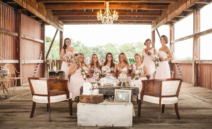 I had seven bridesmaids and two maids-of-honor. I knew I wanted my girls to be in pink dresses. The dresses were classic, soft and romantic, says Paige.