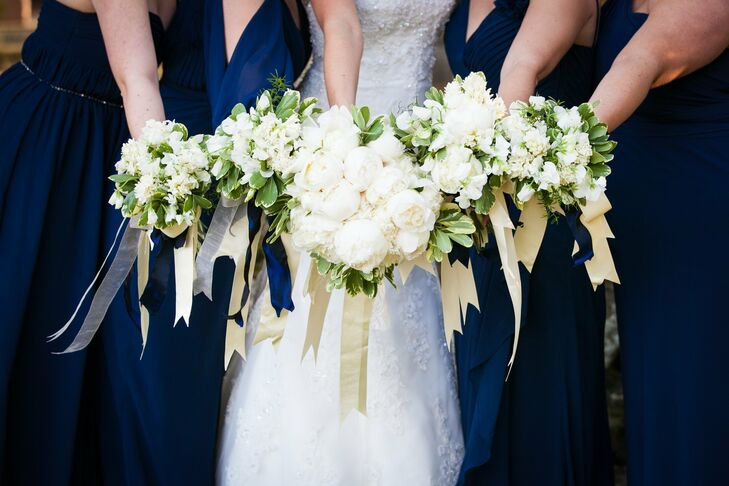 Jenn's bouquet was filled with white peonies accented by variegated greenery.
