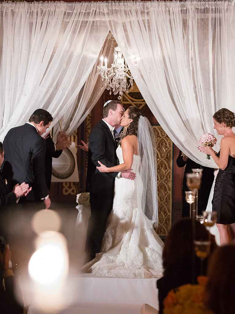 Hang a crystal chandelier from a sheer fabric curtain for an elegant wedding arch
