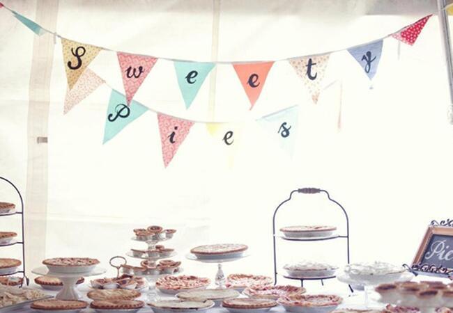 A pie bar dessert spread at a wedding.