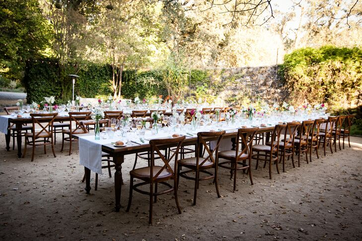 """Our guests dined at two long rows of rectangular Tuscan farmhouse tables arranged end-to-end, which were set up inside the Annadel ruins,"" says Brooke. Adding bistro lighting to the top of the stone structure created a ceiling of light as the sun set over the reception dinner."