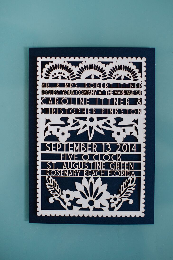"By working with Studio EQ through Etsy, Caroline and Christopher designed an invitation that resembled the papel picados in their reception. ""I searched high and low on Etsy to find the right person to do it at the right price,"" Caroline says. Each one had this white floral cut-out design along the front."